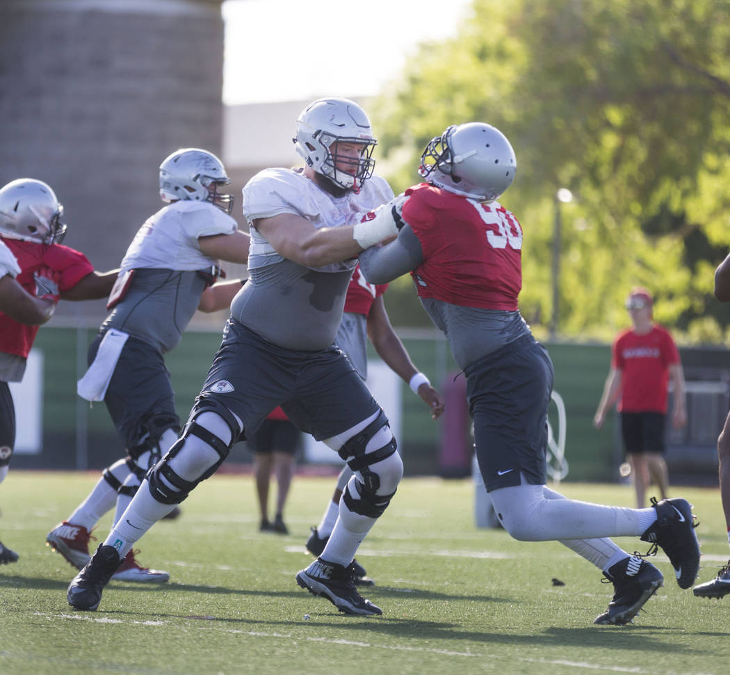 UNLV offensive left tackle Kyle Saxelid (76), left, and defensive lineman Jalil Briley participate in drills during football practice at UNLV's Rebel Park in Las Vegas, Tuesday, Aug. 22, 2017. Eli ...