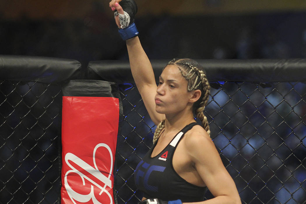 Pearl Gonzalez enters the ring during a strawweight mixed martial arts bout at UFC 210, Saturday, April 8, 2017, in Buffalo, N.Y. (AP Photo/Jeffrey T. Barnes)
