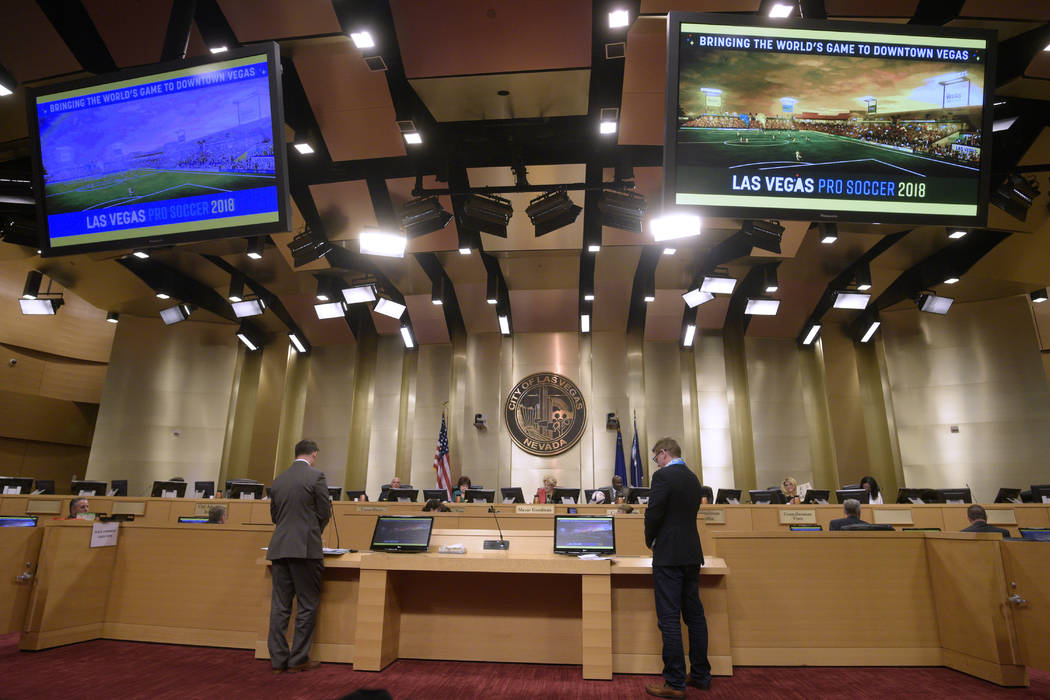 City of Las Vegas Director of Economic and Urban Development Bill Arent, left, and Las Vegas Soccer LLC founder and president Brett Lashbrook make a presentation during a meeting of the Las Vegas  ...