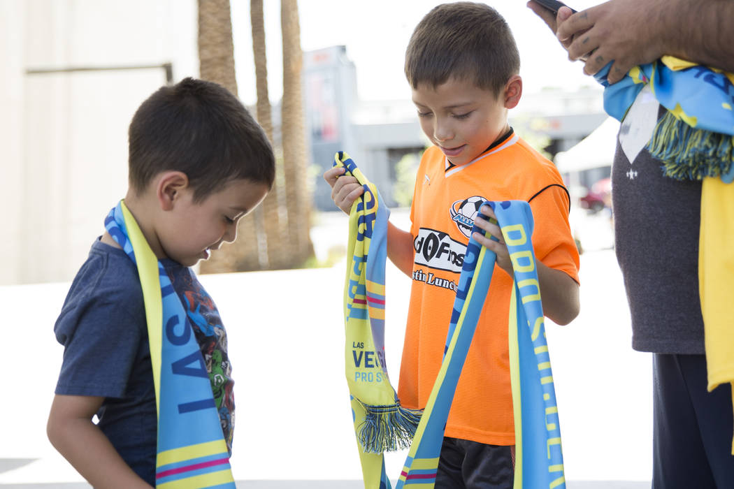 Alexander Vargas, 5, left, and his brother Emmanuel, wear Las Vegas Pro Soccer scarves during an United Soccer League event to celebrate the newest team in the league at the Zappos campus in Las V ...