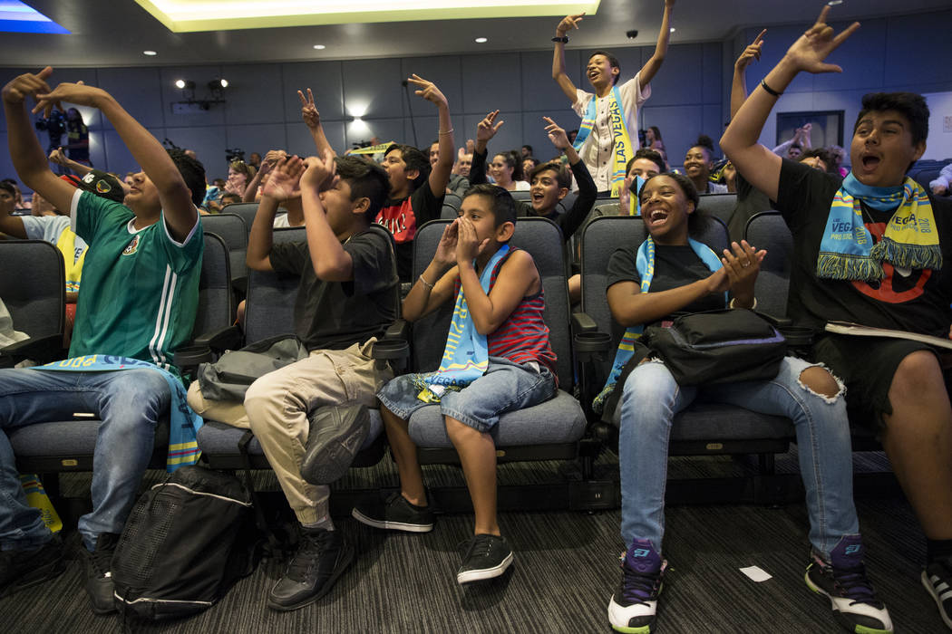 Children with the Boys & Girls Clubs of Southern Nevada from left, Christopher Ramirez, 13, Mark Cortez, 12, Samuel Seoane, 11, Amiyah Jordan, 14, and Sebastian Manzo, 15, cheer during an Unit ...
