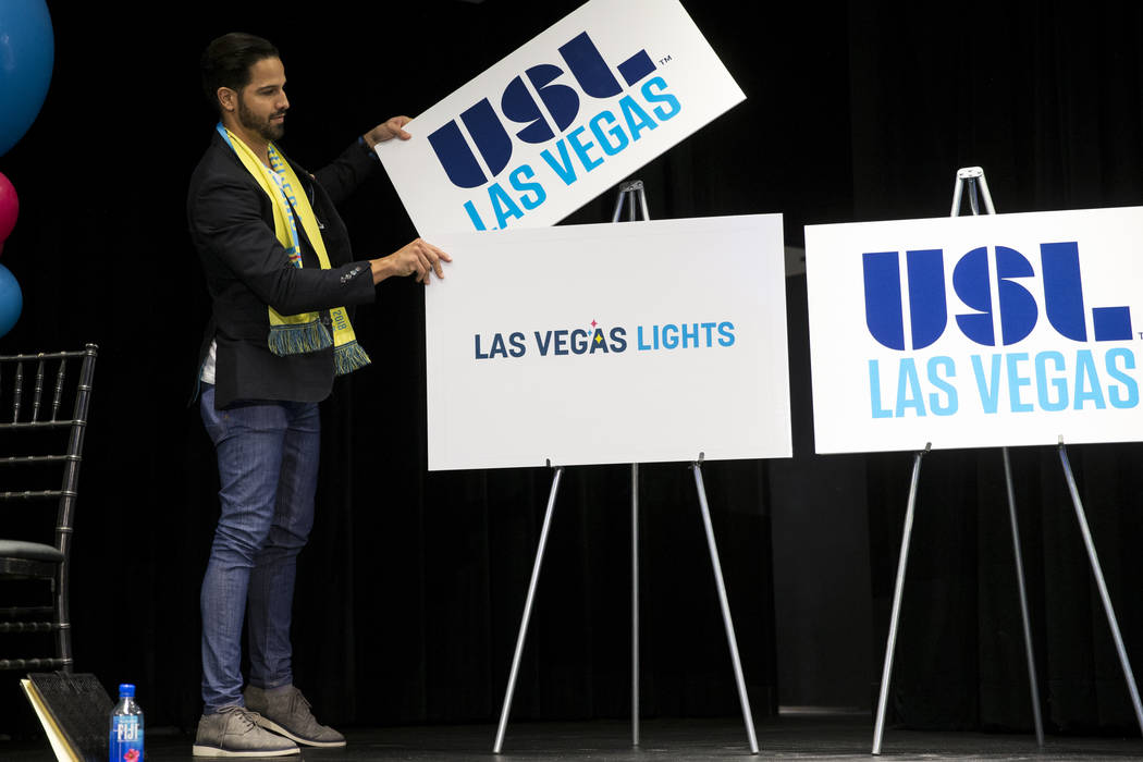 Ricardo Laguna, professional BMX rider and television personality, reveals one of six possible names for the future United Soccer League Las Vegas soccer team during an event at the Zappos campus  ...