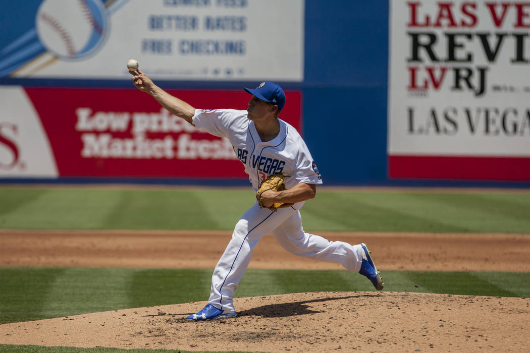 In this file photo, Las Vegas 51s pitcher Mitch Atkins pitches against the Salt Lake Bees on Sunday, June 25, 2017.  On Tuesday, Aug. 8, 2017, Atkins gave up three runs to Reno and was tagged with ...