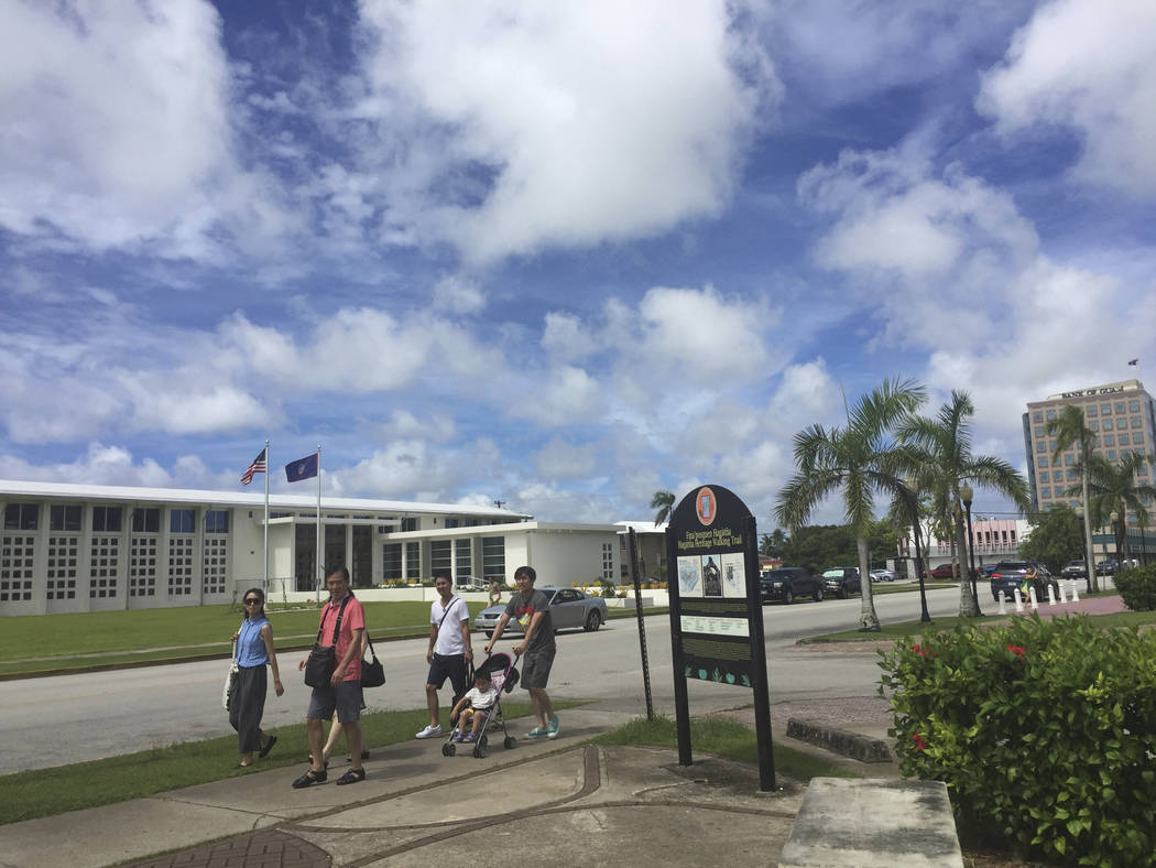 People walk around Hagatna, Guam Wednesday, Aug. 9, 2017. Despite government assurances, residents of the U.S. territory Guam say they're afraid after being caught in the middle of rising t ...