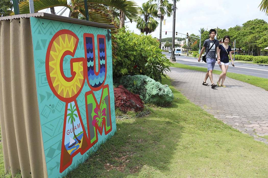 In this May 15, 2017, file photo, tourists walk through a shopping district in Tamuning, Guam. Security and defense officials on Guam said on Aug. 9, 2017, that there is no imminent threat to peop ...
