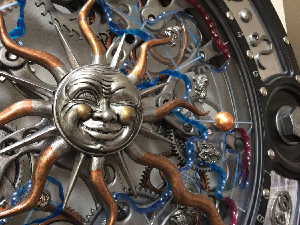 "A close up of ""Astronomical Clock"" by Dale Mathis, is seen July 25, 2017. It shows the gears and underpinnings of the piece, which has a small motor to make it work. Mathis has limited edition ..."