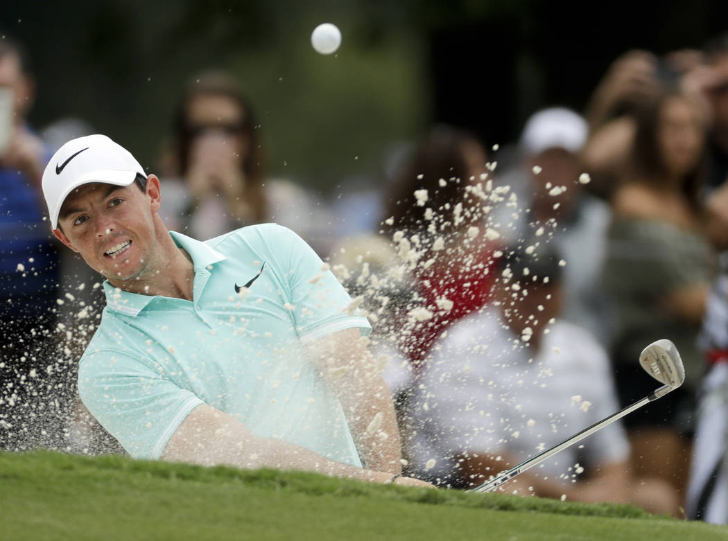 Rory McIlroy of Northern Ireland, hits from the bunker on the ninth hole during a practice round at the PGA Championship golf tournament at the Quail Hollow Club Wednesday, Aug. 9, 2017, in Charlo ...
