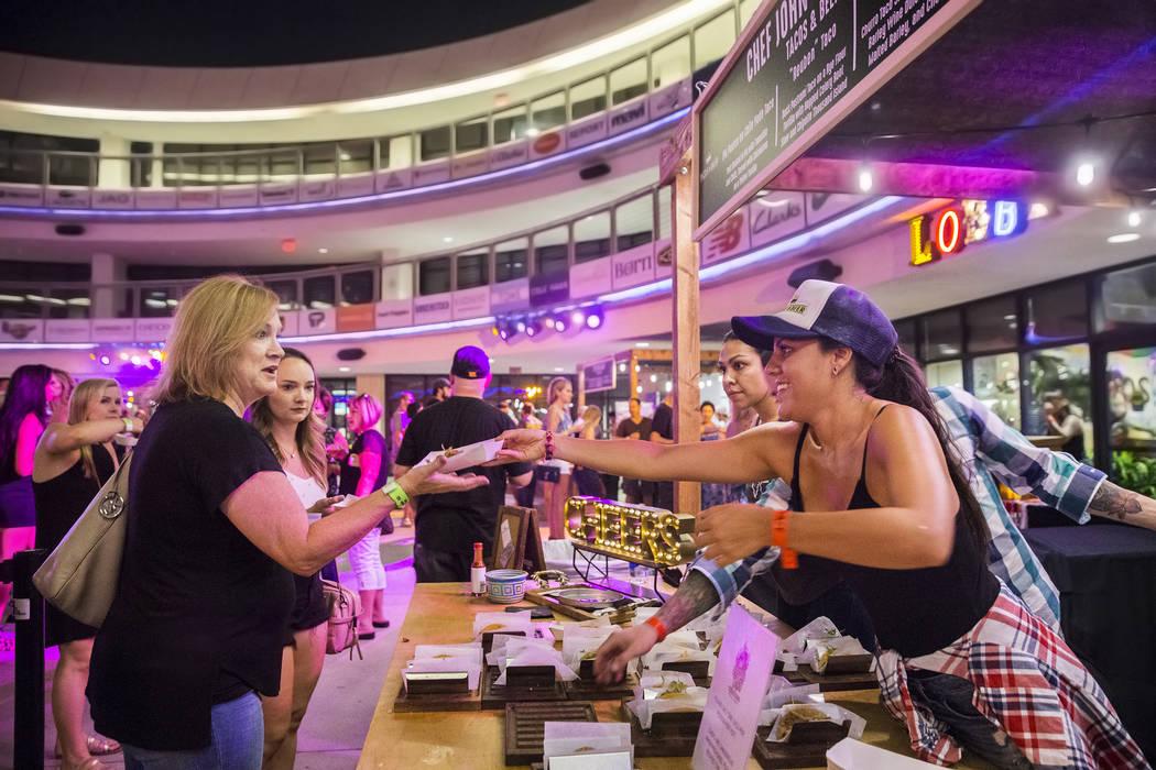 Fernanda Jacquez, right, serves reuben tacos by chef John Simmons at Tacos & Beer during the Hopped Taco Throwdown on Saturday, Aug 12, 2017, at Zappos, in Las Vegas. (Benjamin Hager/Las Vegas ...