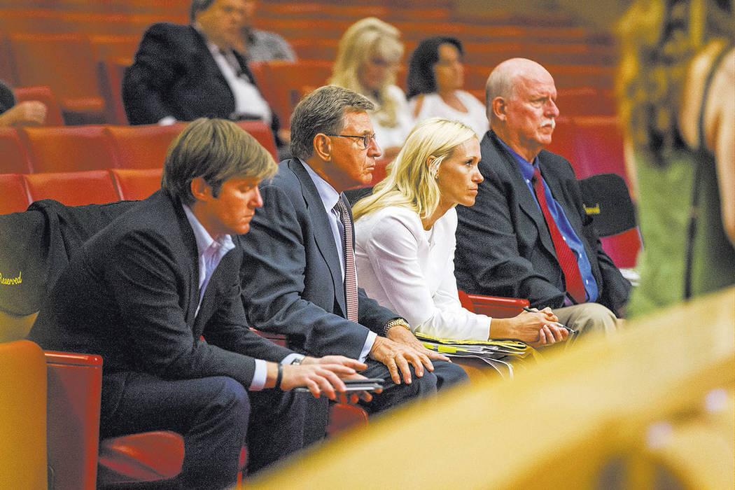 From left, Brett Harrison, executive vice president of EHB Cos., Frank Pankratz, president of EHB Cos., attorney Stephanie Allen, and attorney Chris Kaempfer wait for a vote about the Badlands gol ...