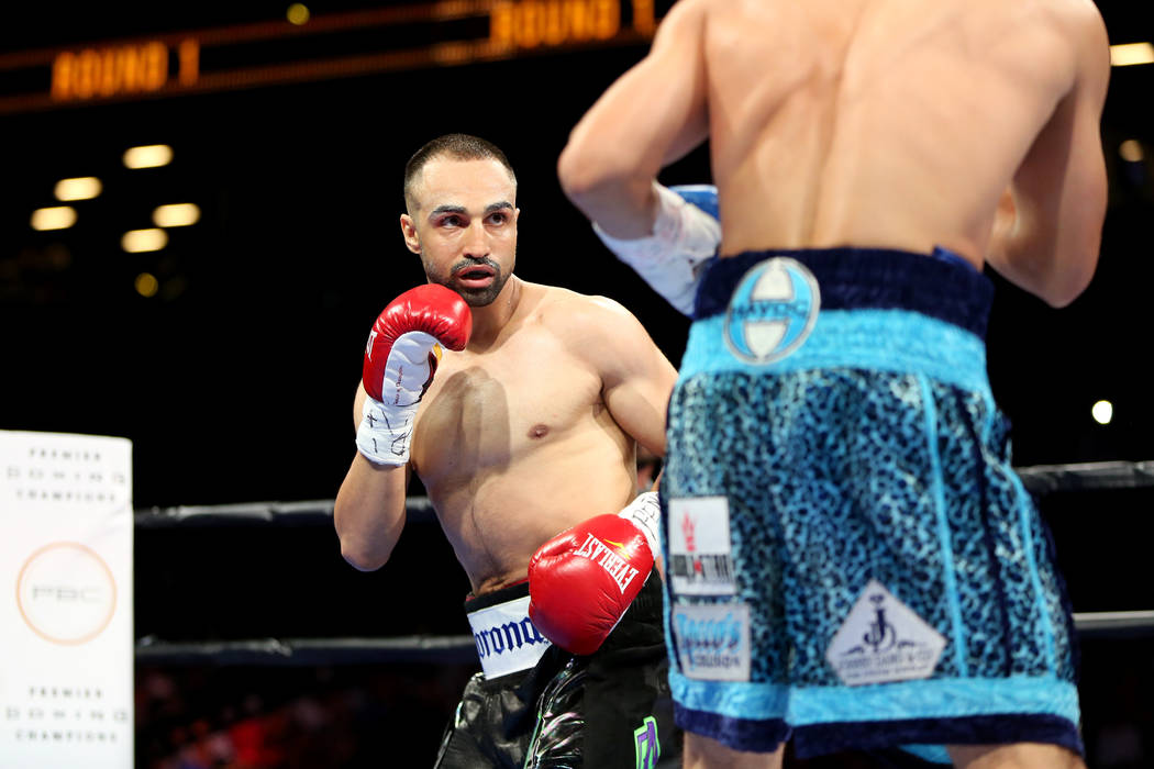 Paul Malignaggi in action against Danny Garcia during their welterweight fight at the Barclays Center in Brooklyn, on Saturday, August 1, 2015. Garcia won via TKO in Round 9.  (AP Photo/Gregory Payan)