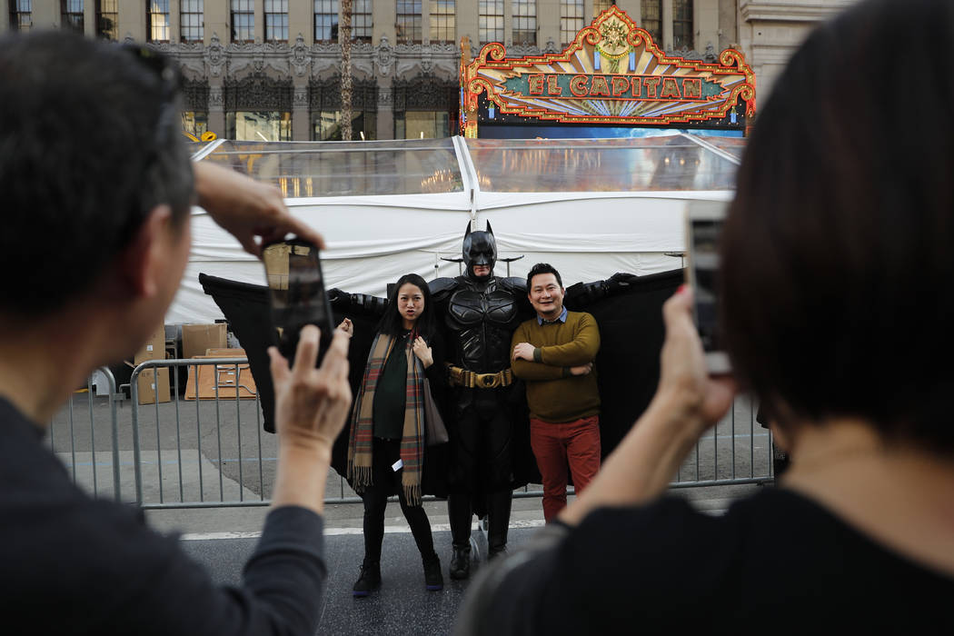 Superhero impersonator Matthias Balke poses with tourists on Hollywood Boulevard near the Dolby Theatre in Los Angeles on Thursday, March 2, 2017. (AP Photo/Jae C. Hong)