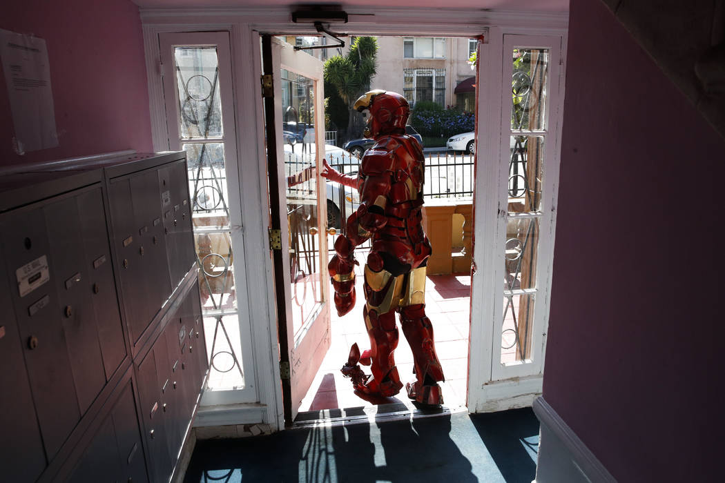 "Wearing a $5,000 Iron Man costume, actor Paul Louis Harrell leaves his apartment building, in the Hollywood section of Los Angeles on In this Sunday, June 4, 2017 photo. ""I'm successful because I  ..."
