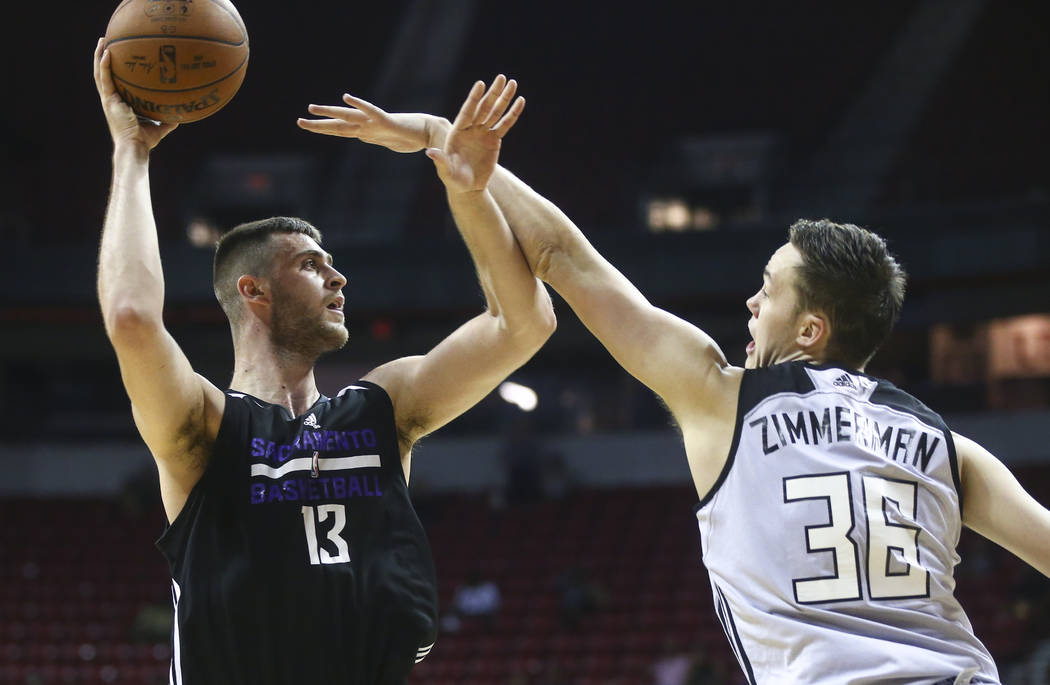 Sacramento Kings' Georgios Papagiannis (13) shoots over Milwaukee Bucks' Stephen Zimmerman (36) during a basketball game at the NBA Summer League at the Thomas & Mack Center in Las Vegas on We ...