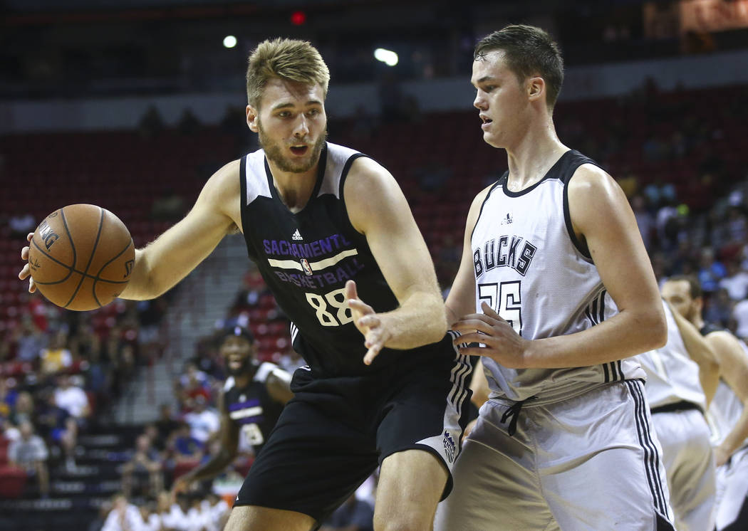 Sacramento Kings' Eric Stuteville (88) drives against Milwaukee Bucks' Stephen Zimmerman (36) during a basketball game at the NBA Summer League at the Thomas & Mack Center in Las Vegas on Wedn ...