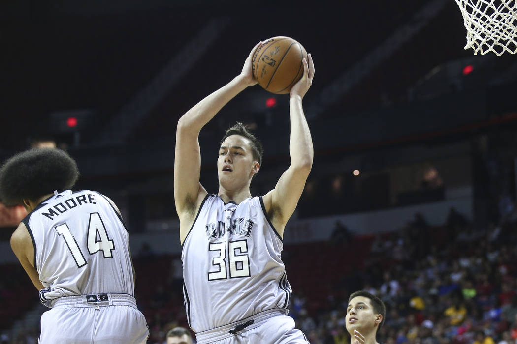 Milwaukee Bucks' Stephen Zimmerman (36) gets a rebound over the Sacramento Kings during a basketball game at the NBA Summer League at the Thomas & Mack Center in Las Vegas on Wednesday, July 1 ...