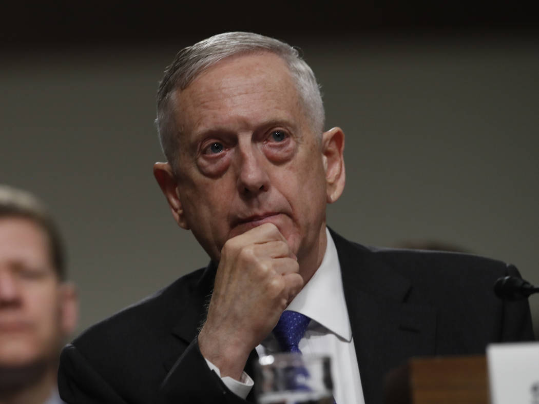 FILE - In this June 13, 2017 file photo, Defense Secretary Jim Mattis listens on Capitol Hill in Washington. Mattis is issuing his own sharp threat to North Korea, saying the regime should cease a ...