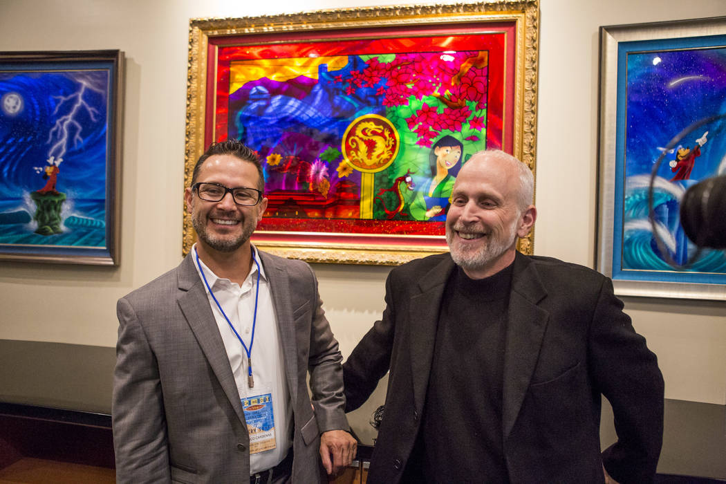 Francisco Cardenas, gallery director, left, and Niel Cantor, managing director, during the grand opening of the Magical Memories Disney Fine Art Gallery in the Forum Shops at Caesars on Thursday,  ...