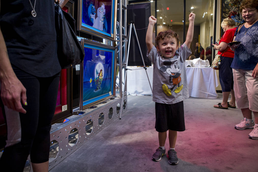 Gus Karris, 4, expresses his excitement during the grand opening of the Magical Memories Disney Fine Art Gallery in the Forum Shops at Caesars on Thursday, Aug. 10, 2017.  Patrick Connolly Las Veg ...