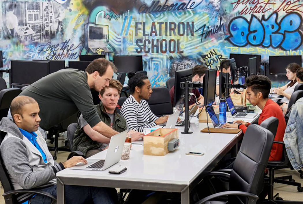 Poeple work on computers at the Flatiron School in San Francisco in May 2015. (Courtesy of the Flatiron School/Handout via Reuters)