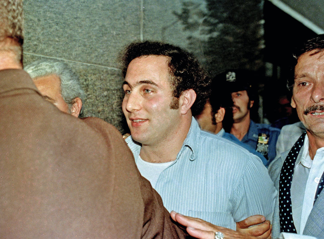 David Berkowitz, center, the Son of Sam killer, is in the custody of police August 11, 1977, after his arrest in New York. Thursday, Aug. 10, 2017, is the 40th anniversary of Berkowitz's capture.  ...