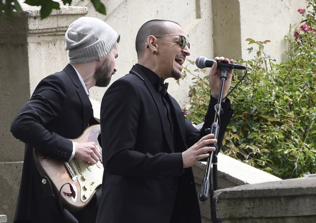 "Chester Bennington of Linkin Park performs ""Hallelujah"" at a funeral for Chris Cornell at the Hollywood Forever Cemetery in Los Angeles on May 26. (Chris Pizzello/Invision/AP, File)"