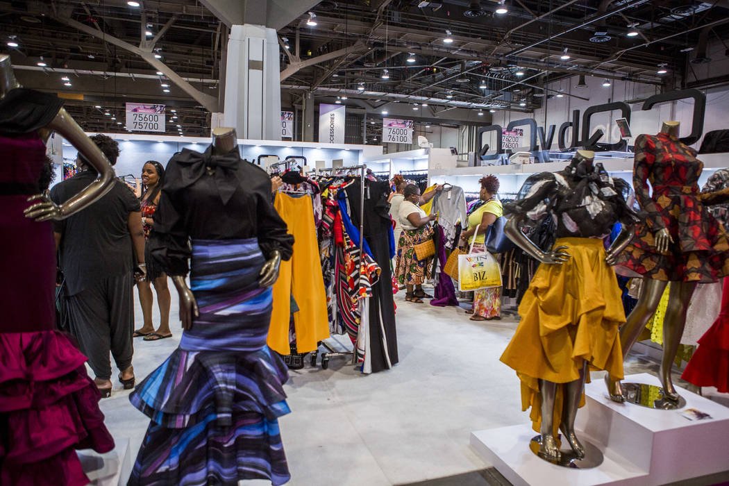 Attendees browse clothing from CQbyCQ at the MAGIC trade show inside the Las Vegas Convention Center on Monday, Aug. 14, 2017.  Patrick Connolly Las Vegas Review-Journal @PConnPie