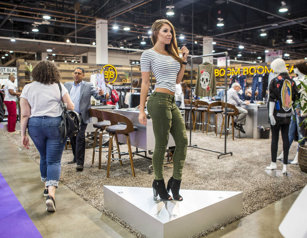 Christina Brooklyn, a model for Boom Boom Jeans, shows off some apparel at the MAGIC trade show inside the Las Vegas Convention Center on Tuesday, Aug. 15, 2017.  Patrick Connolly Las Vegas Review ...