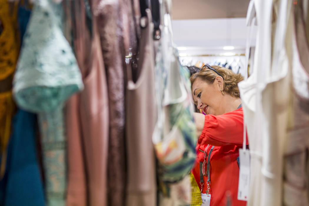 Leticia Martinez browses a selection of dresses at the MAGIC trade show inside the Las Vegas Convention Center on Tuesday, Aug. 15, 2017.  Patrick Connolly Las Vegas Review-Journal @PConnPie