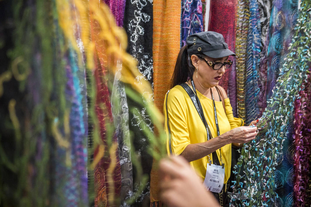 Iris Sanchez of Tucson, Ariz. browses scarves by Elegant Additions at the MAGIC trade show inside the Las Vegas Convention Center on Tuesday, Aug. 15, 2017.  Patrick Connolly Las Vegas Review-Jour ...