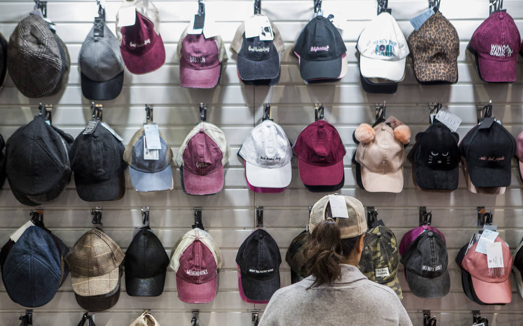 Gina Shin organizes hats by the David & Young Group at the MAGIC trade show inside the Las Vegas Convention Center on Tuesday, Aug. 15, 2017.  Patrick Connolly Las Vegas Review-Journal @PConnPie