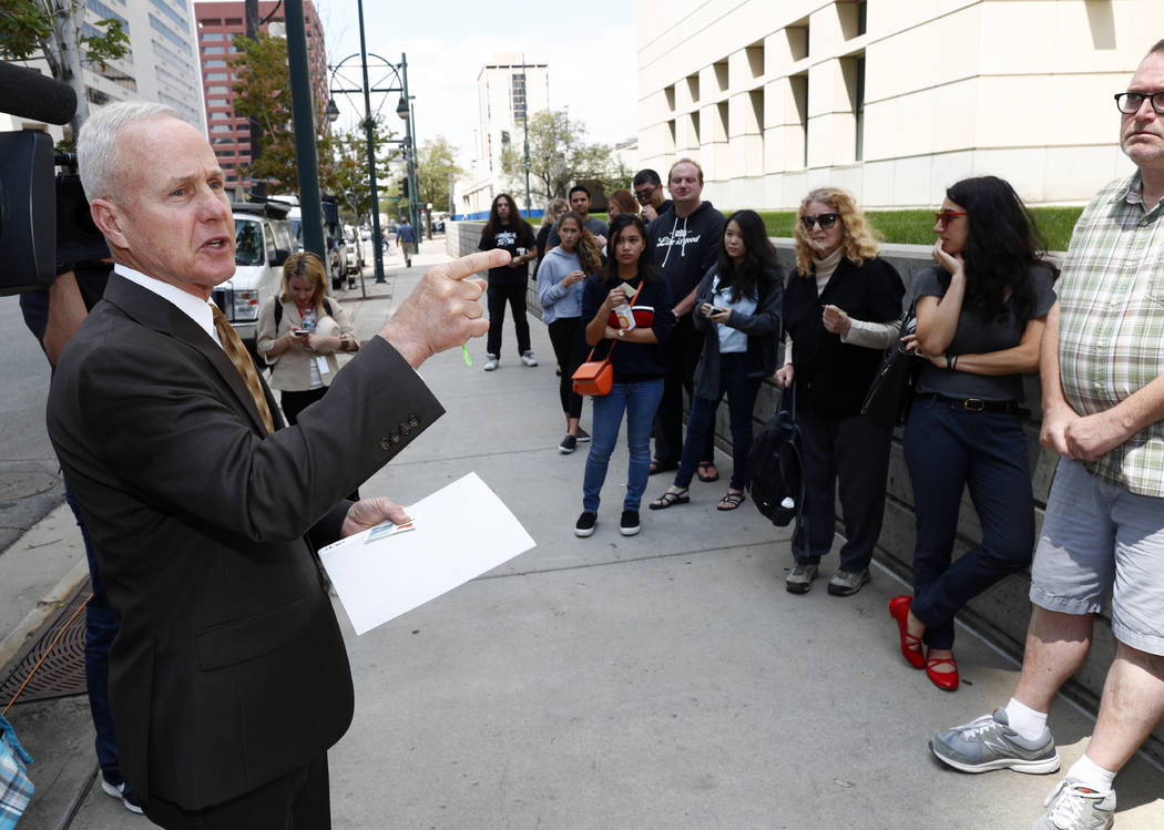 A court officer directs members of the public into the federal courthouse to view the afternoon session of the third day of a civil trial to determine whether a radio host groped pop singer Taylor ...