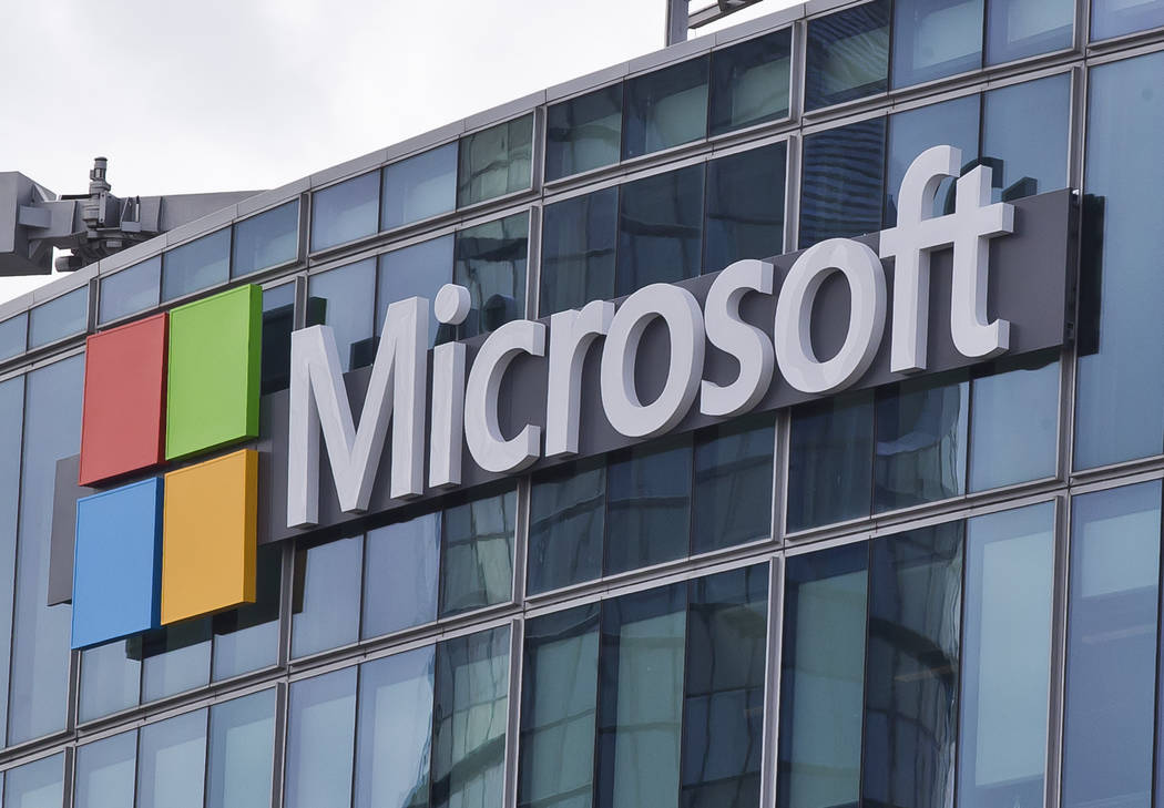 FILE - This April 12, 2016, file photo shows the Microsoft logo in Issy-les-Moulineaux, outside Paris, France. Consumer Reports said Thursday, Aug. 10, 2017, that it can no longer recommend multip ...