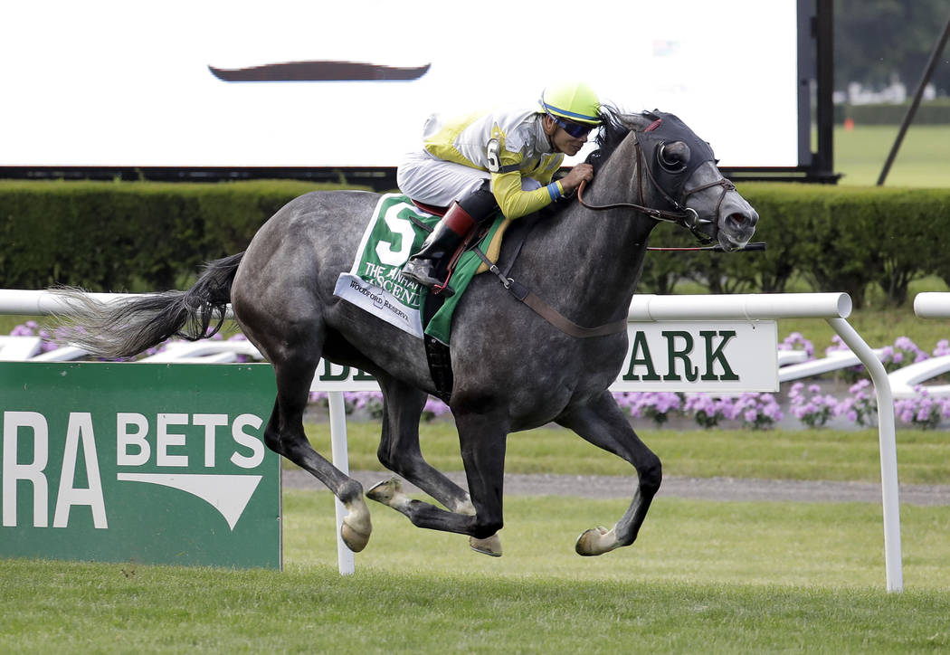 Ascend, ridden by Jose Ortiz, crosses the finish line to win the Woodford Reserve Manhattan at Belmont Park on Saturday, June 10, 2017, in Elmont, N.Y. (AP Photo/Julio Cortez)