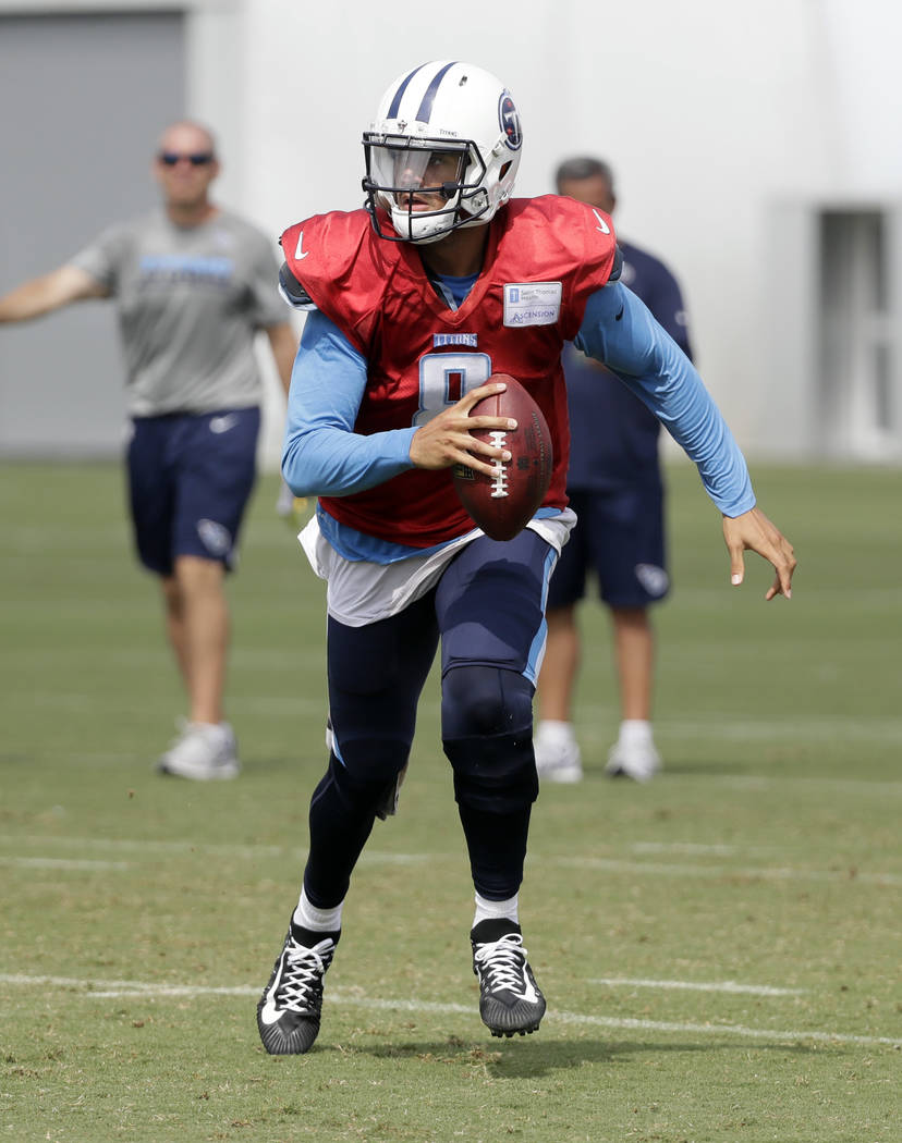 Tennessee Titans quarterback Marcus Mariota (8) runs a play during NFL football training camp Thursday, Aug. 10, 2017, in Nashville, Tenn. (AP Photo/Mark Humphrey)