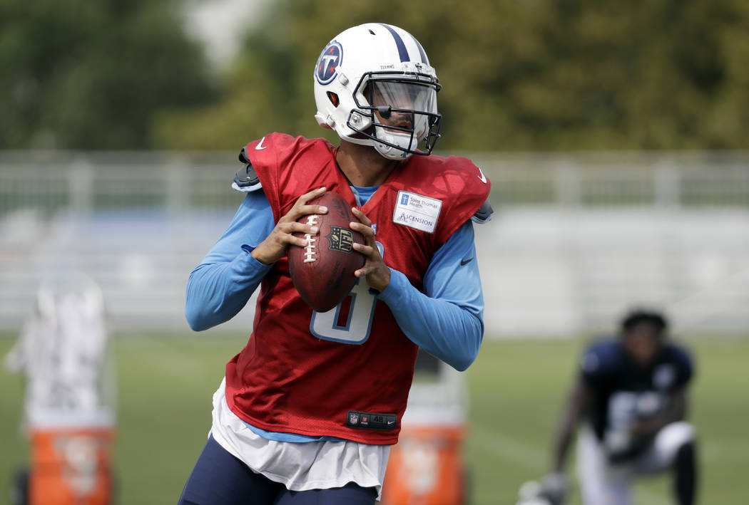 Tennessee Titans quarterback Marcus Mariota passes during NFL football training camp Thursday, Aug. 10, 2017, in Nashville, Tenn. (AP Photo/Mark Humphrey)