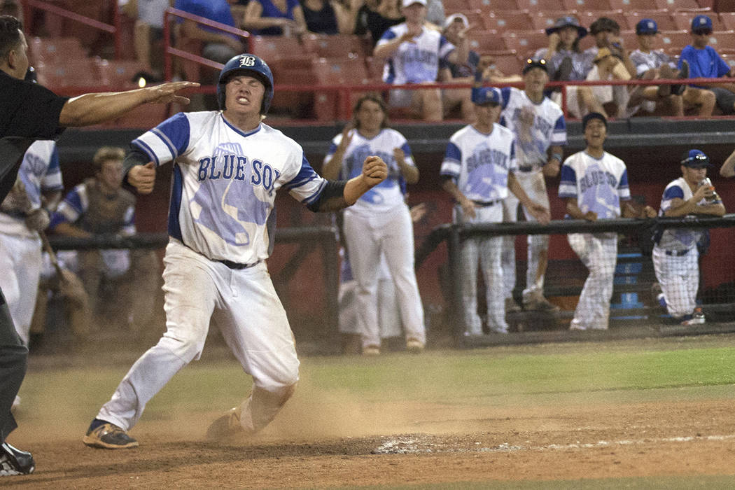 Southern Nevada Blue Sox's Jack-Thomas Wold (19) reacts after making a home run against the Las Vegas Aces on Saturday, July 29, 2017, at the American Legion Baseball Nevada State Tournament champ ...