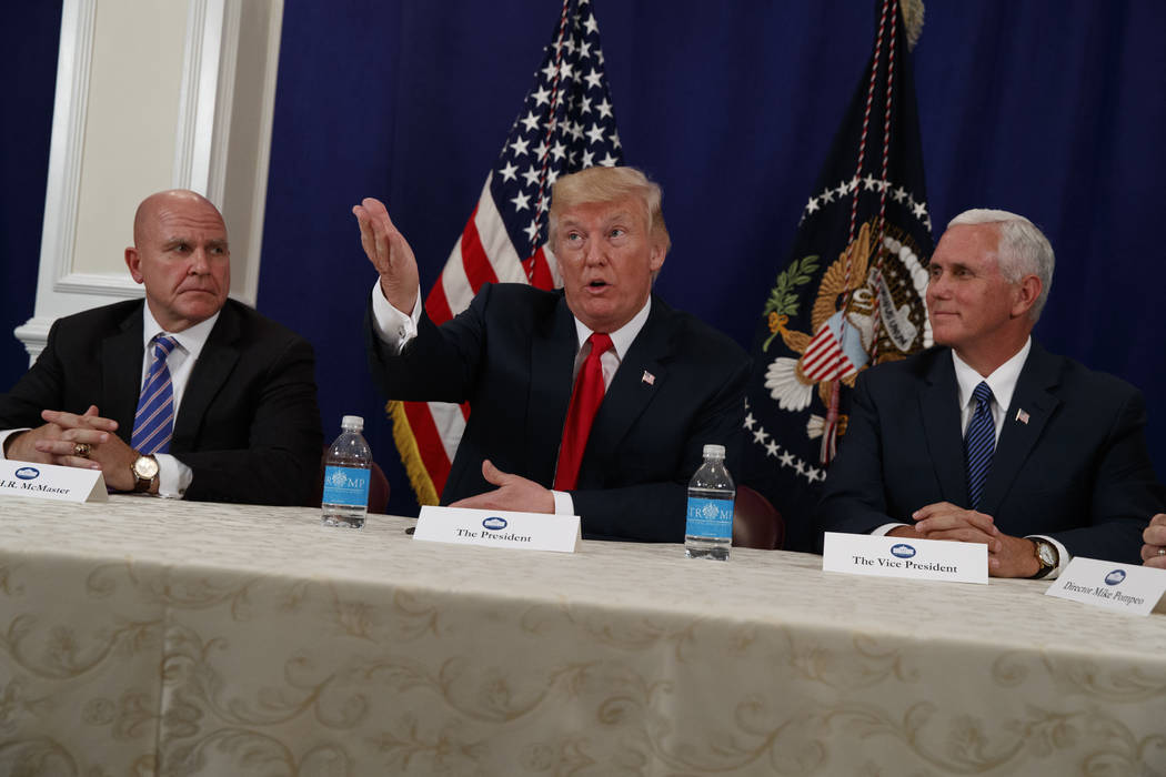 National Security Adviser H.R. McMaster, left, and Vice President Mike Pence listen as President Donald Trump speaks to reporters after a security briefing at Trump National Golf Club in Bedminste ...