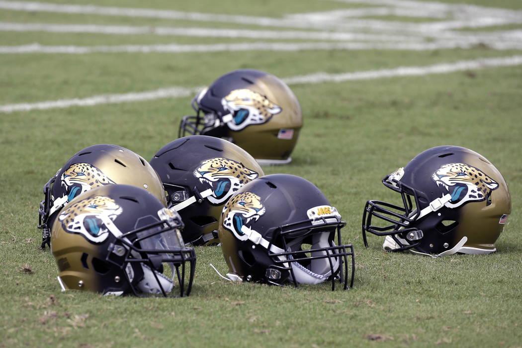 Jacksonville Jaguars players helmets on the sidelines during NFL football training camp, Thursday, July 27, 2017, in Jacksonville, Fla. (AP Photo/John Raoux)