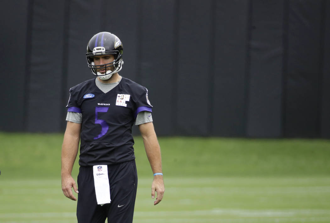 In this May 25, 2017, file photo, Baltimore Ravens quarterback Joe Flacco walks on the field during NFL football practice at the team's practice facility, in Owings Mills, Md. (AP Photo/Patrick Se ...