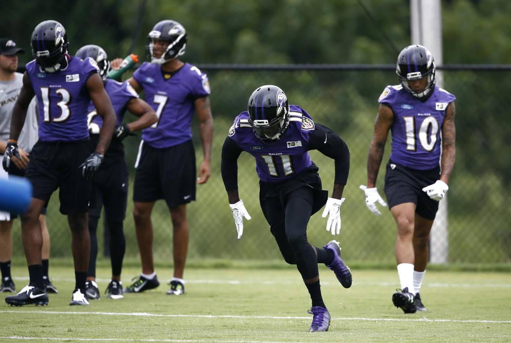 Baltimore Ravens wide receiver Breshad Perriman (11) runs a drill during an NFL football training camp practice in Owings Mills, Md., Thursday, July 27, 2017. (AP Photo/Patrick Semansky)