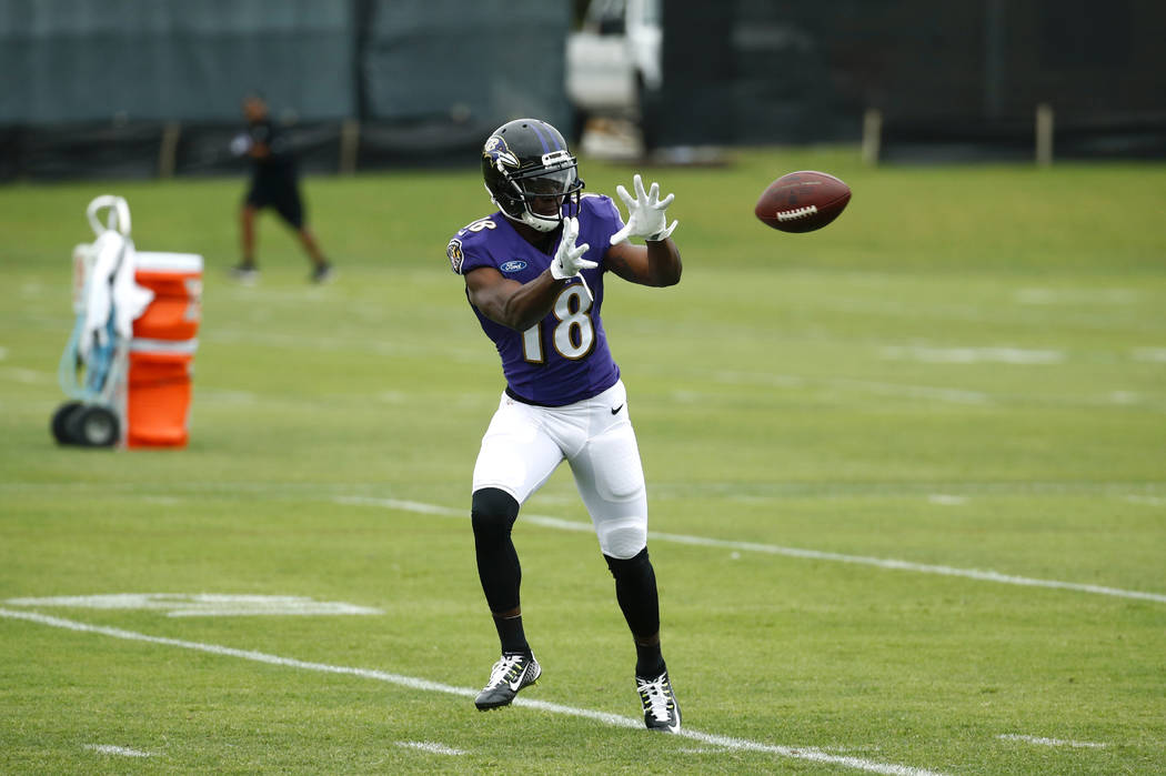 Baltimore Ravens wide receiver Jeremy Maclin catches a pass during an NFL football training camp practice in Owings Mills, Md., Saturday, July 29, 2017. (AP Photo/Patrick Semansky)