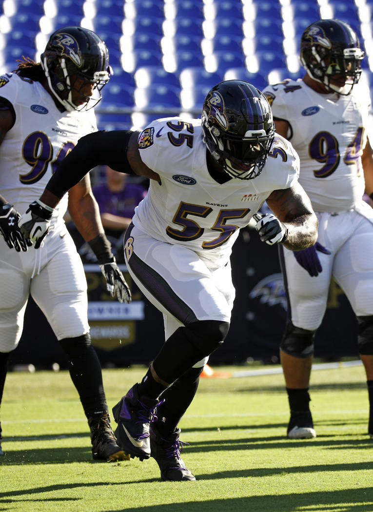 Baltimore Ravens outside linebacker Terrell Suggs (55) runs a drill during an NFL football training camp practice in Baltimore, Sunday, July 30, 2017. (AP Photo/Patrick Semansky)