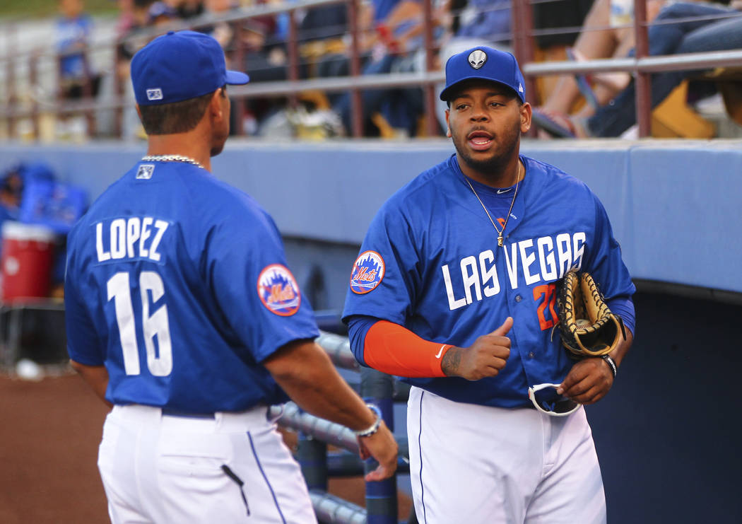 Las Vegas 51s manager Pedro Lopez (16) talks with Las Vegas 51s first baseman Dominic Smith (22) before a baseball game against the Fresno Grizzlies at Cashman Field in Las Vegas on Thursday, Apri ...