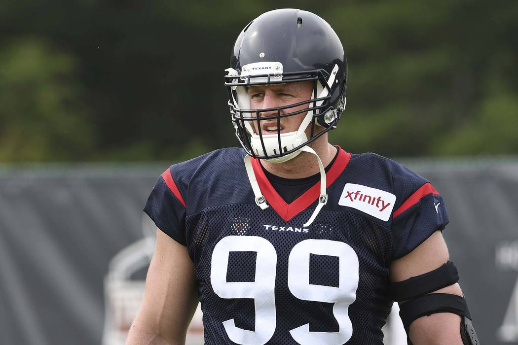 Jul 27, 2017; Greenbrier, WV, USA; Houston Texans defensive end J.J. Watt (99) stretches during training camp at The Greenbrier. (Michael Shroyer-USA TODAY Sports)