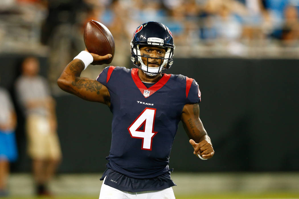 Aug 9, 2017; Charlotte, NC, USA; Houston Texans quarterback Deshaun Watson (4) looks to pass the ball against the Carolina Panthers at Bank of America Stadium. (Jeremy Brevard-USA TODAY Sports)