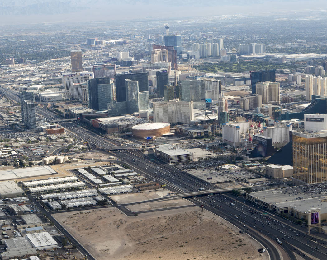 An aerial view of the Raiders stadium site in Las Vegas, lower left, on Wednesday, July 26. Heidi Fang Las Vegas Review-Journal @HeidiFang