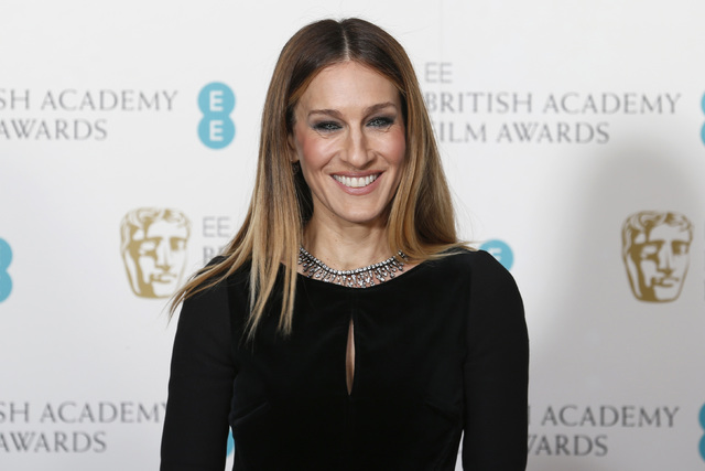 Sarah Jessica Parker poses for photographers at the British Academy of Film and Arts awards ceremony at the Royal Opera House in London Feb. 10, 2013. (Suzanne Plunkett/Reuters)