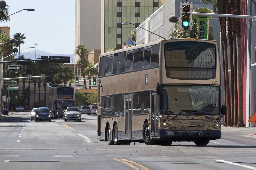 A Regional Transportation Commission bus turns onto North Las Vegas Boulevard from East Carson Avenue in downtown Las Vegas. (Richard Brian/Las Vegas Review-Journal) @vegasphotograph