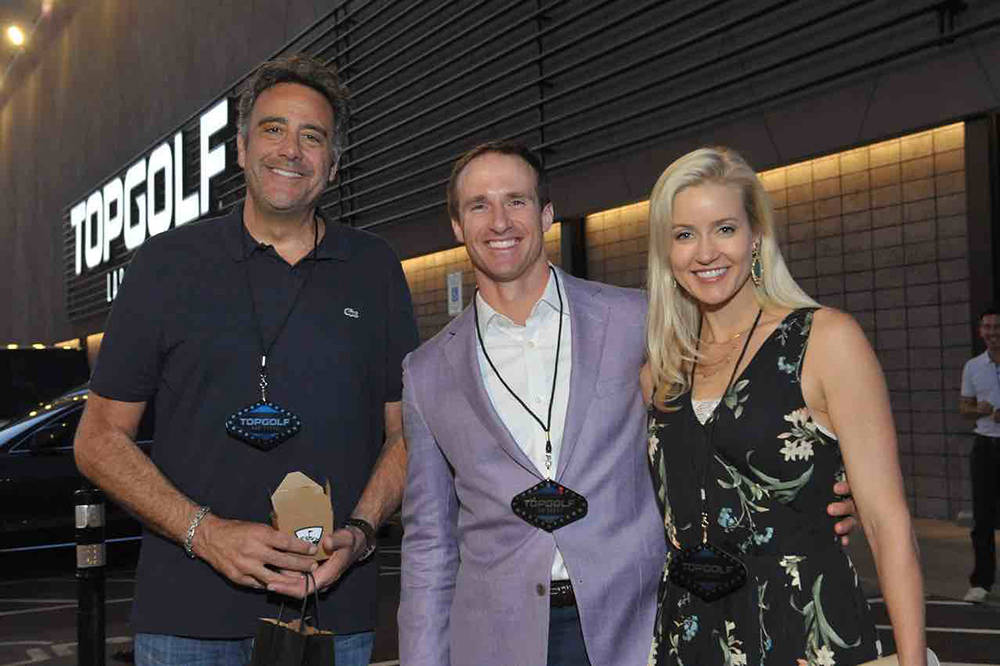 Brad Garrett, Drew Brees and Brittany Brees at Top Golf. (Michael Baxter, Baxter Imaging LLC)