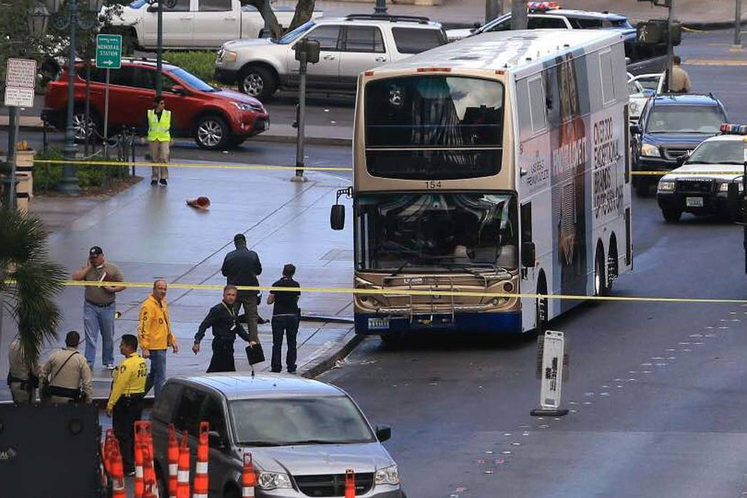 Police investigate the scene of a shooting on an RTC bus that left one person dead and one injured outside the Cosmopolitan, March 25, 2017. (Brett Le Blanc/Las Vegas Review-Journal) @bleblancphoto